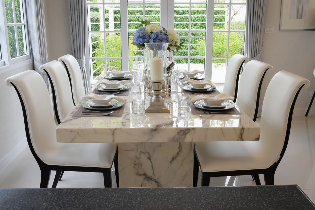 Dining table and comfortable chairs in vintage style with elegan